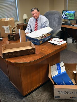 Alex Mills, president of the Texas Alliance of Energy Producers, packs up his office in the Hamilton Building in preparation for retirement from the position he's held for 24 years.