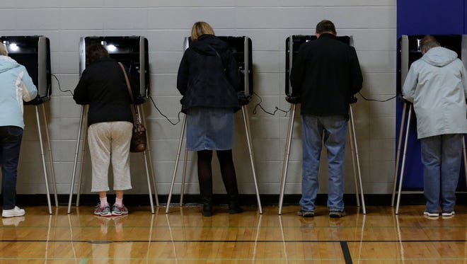 Voters cast their votes on Tuesday, November 8, 2016.  Voters lined up to vote in Wards 19 and 20 at Carl Traeger School in Oshkosh.  When polls opened the wait was about 40 minutes after the morning rush cleared around 9 a.m. there was no waiting.  Joe Sienkiewicz / USA TODAY NETWORK-Wisconsin