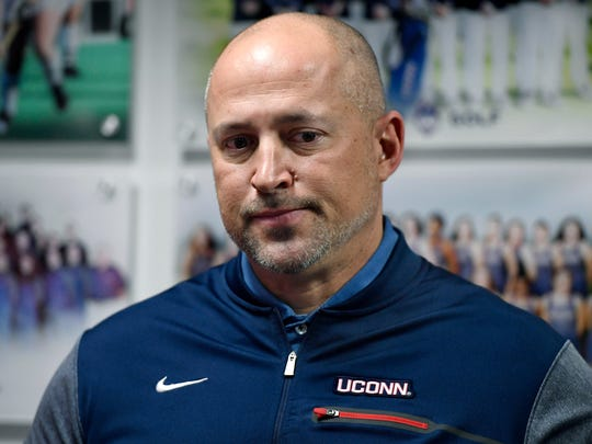 Connecticut athletic director David Benedict holds a news conference in his office at the University of Connecticut, Saturday, Jan. 19, 2019, in Storrs, Conn. Benedict says the school has not ruled out eliminating some sports to close a more than $40 million gap in its athletic budget.  (AP Photo/Jessica Hill)
