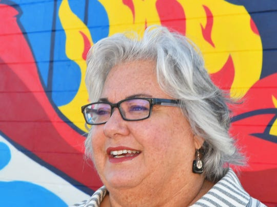 Lisa Packard, executive director of the Eau Gallie Arts District (EGAD) in front of the new mural by artist Matt Gondek on Eau Gallie Blvd., just west of U.S.#1, Harbor City Blvd.) in Melbourne.