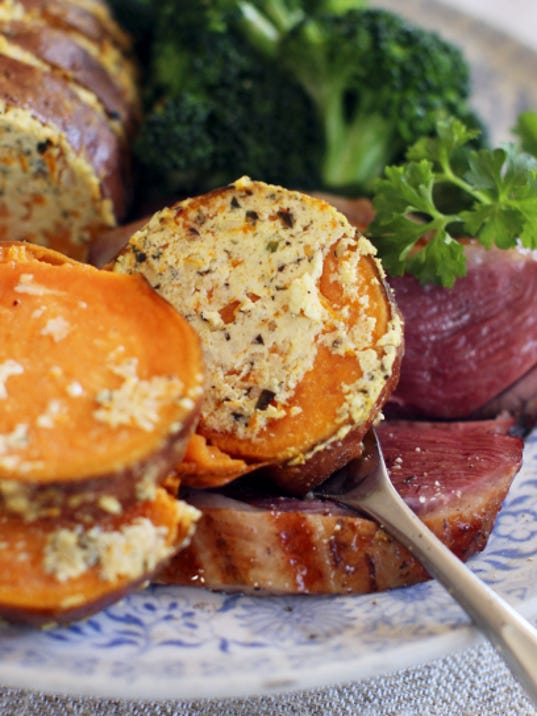Goat cheese is stuffed into sweet potatoes that are finished on the grill.