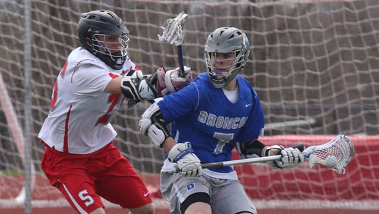 Bronxville's Alston Tarry looks for an opening past