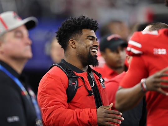 Dallas Cowboys running back watches from the Ohio State bench area as his former school beats USC 24-7 in the Cotton Bowl.