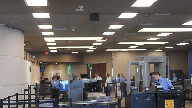 Passengers go through the new security checkpoint area at the Sioux Falls Regional Airport earlier this year.