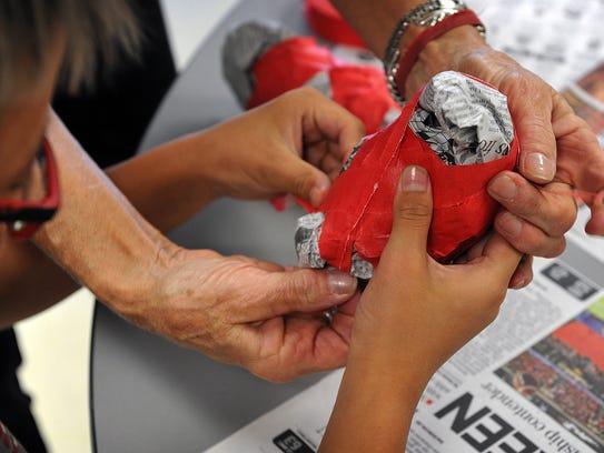 Using crumpled newspaper and masking tape, children