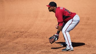 Arizona Diamondbacks first baseman Yasmany Tomas fields against the Colorado Rockies during spring training action at Salt River Fields at Talking Stick on March 29, 2015.
