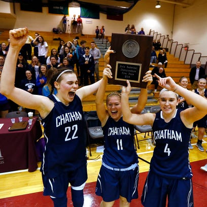 Chatham's Veronica Kelly, l,  celebrates with teammates