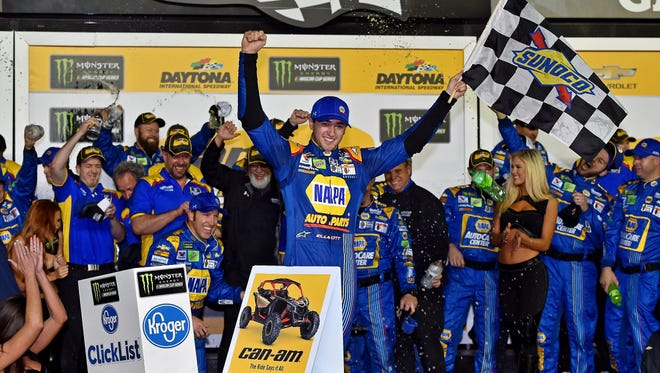 Chase Elliott celebrates with his team after winning the first Can-Am Duel at Daytona Thursday night.