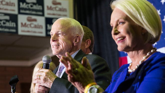 Sen. John McCain with his wife Cindy besides him speaks to his supporters at his campaign headquaters in Phoenix, Ariz. August 30, 2016. McCain faced competition from Kelli Ward for his senate seat in the Arizona Republican primary.