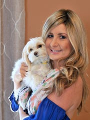 Lindsay Farlow of Melbourne, seen here with her dog Daisy Mae. Lindsay was diagnosed with breast cancer at age 32.