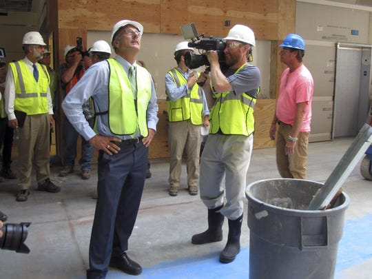 Gov. Peter Shumlin looks at the progress of construction Thursday at the new state office complex in Waterbury.