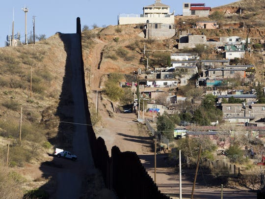 The border fence between the U.S. and Mexico is shown