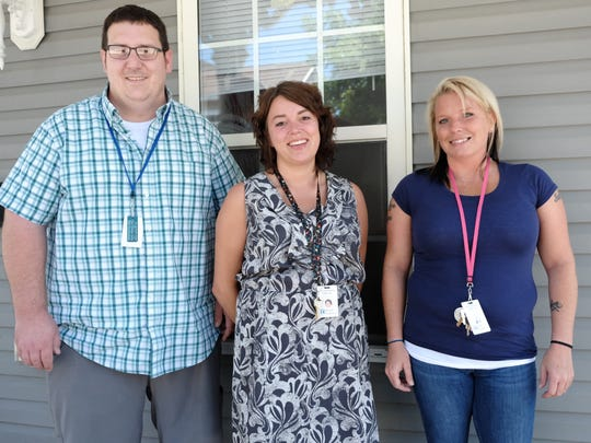 """From left at a """"Mommy and me"""" residence in Milford: Andrew Schmidt, director of sober living; Morgan Chambers, house manager; Julie Wyatt, manager for multiple """"Mommy and me"""" residences. They are all in recovery from addiction."""