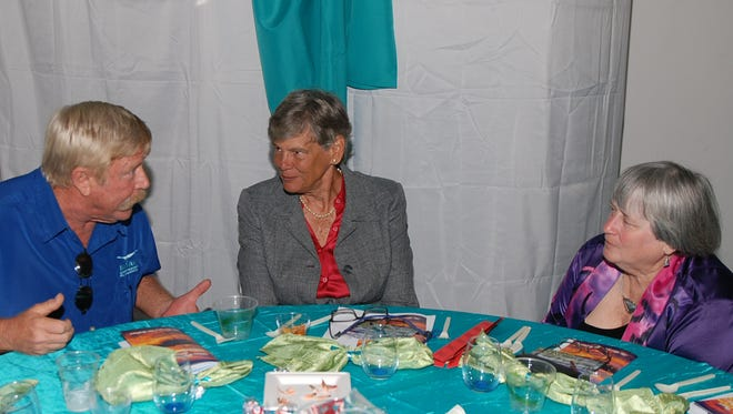 From left, Marty Baum talks with Maggy Hurchalla and Laurilee Thompson during the 2nd Annual Midsummer's Night Fundraiser hosted by the Marine Resources Council on Aug. 2 at the Lagoon House in Palm Bay. Brian Curl, for FLORIDA TODAY