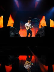 "Ed Sheeran plays during his ""Divide"" tour at Wells Fargo Arena on Friday, June 30, 2017 in Des Moines."