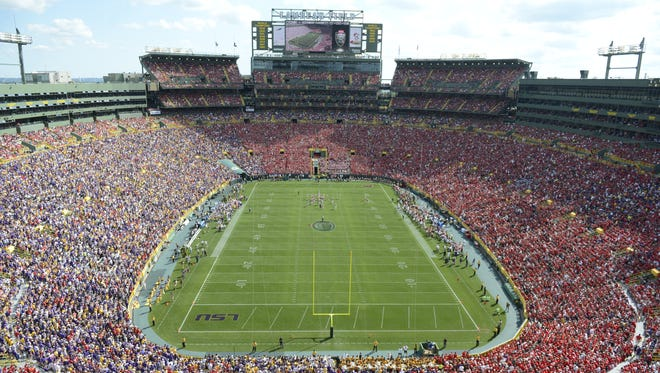 Wisconsin Badgers red and LSU Tigers purple fill Lambeau Field on Sept. 3.