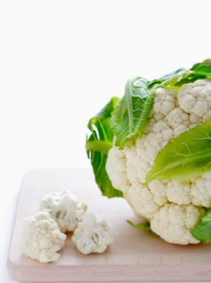 Close-up of cauliflower on cutting board
