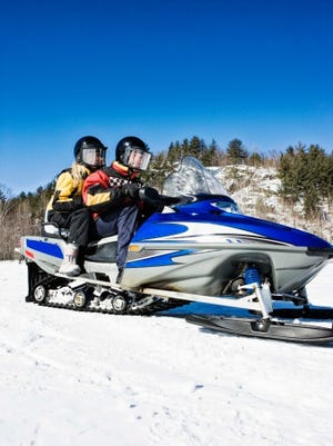 Riding snowmobile