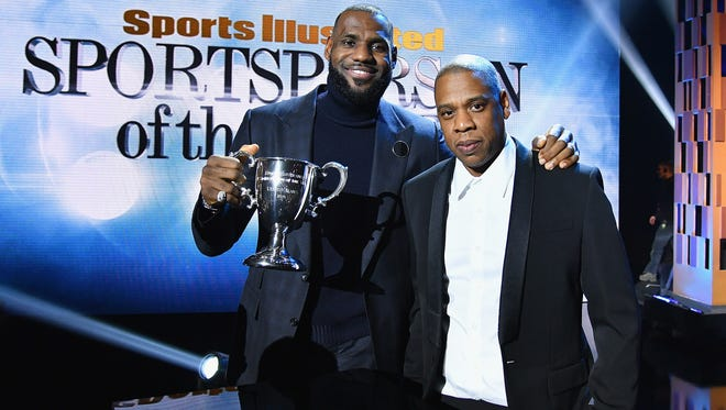 LeBron James and Jay Z pose onstage with an award during the Sports Illustrated Sportsperson of the Year Ceremony 2016 at Barclays Center of Brooklyn on December 12, 2016 in New York City.