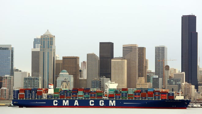 CMA CGM Benjamin Franklin is towed to Seattle's Terminal 18.