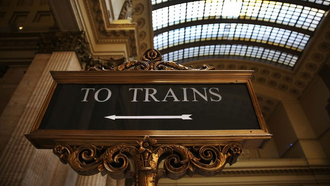 CHICAGO, IL - MARCH 23: A sign points to the direction of the trains at Chicago's Union Station where Amtrak's California Zephyr makes a daily 2,438 miles run to Emeryville/San Francisco that takes about 52 hours.