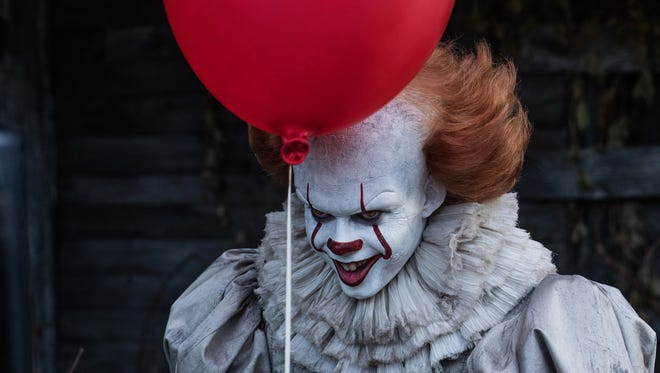 The evil clown Pennywise (Bill Skarsgård) threatens the kids of Derry in 'It.'
