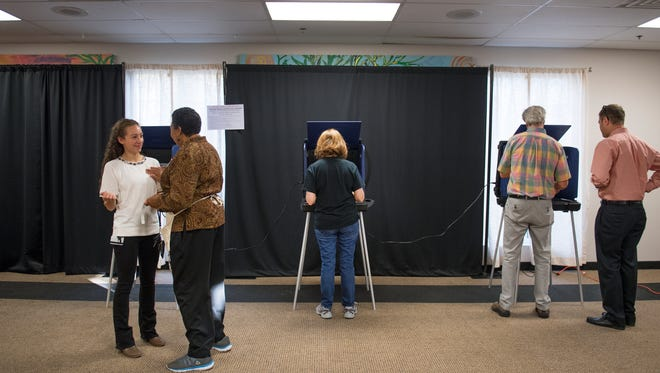 Voters cast their ballots at the West End Community Development Center on Tuesday, November 7, 2017.