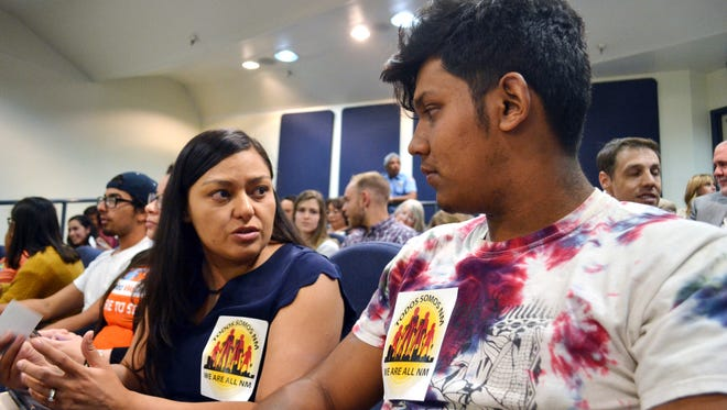 Nora Hernandez, left, of the immigrant advocacy group New Mexico Dream Team, speaks with Javier Solis, a local high school senior, ahead of a City Council meeting on whether to bolster immigrant friendly policies in Albuquerque, New Mexico, on Monday, April 17, 2018. The Albuquerque City Council voted to enact immigrant friendly policies at the meeting, including one that that would bar federal immigration agents from prisoner transport centers without a warrant, and another that would prevent city workers from asking about people's immigration status.