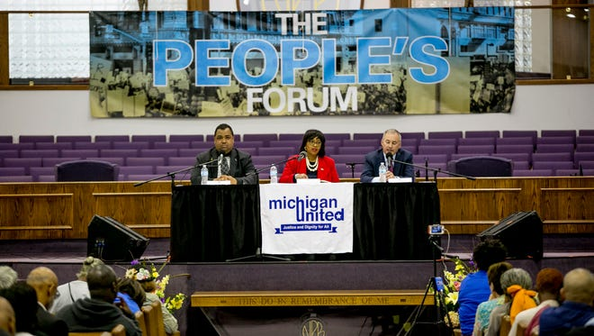 "Candidates Coleman Young Jr., Brenda Jones and Bill Wild sit on stage during People's Candidate Forum"" for the Michigan's 13th congressional district at New Providence Baptist Church in Detroit on June 9, 2018."