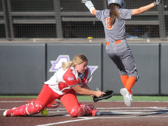 Rotan's Kloe Corn (8) scores on a throwing error in the sixth inning while Hermleigh catcher Sandra Carr can't come up with the throw.