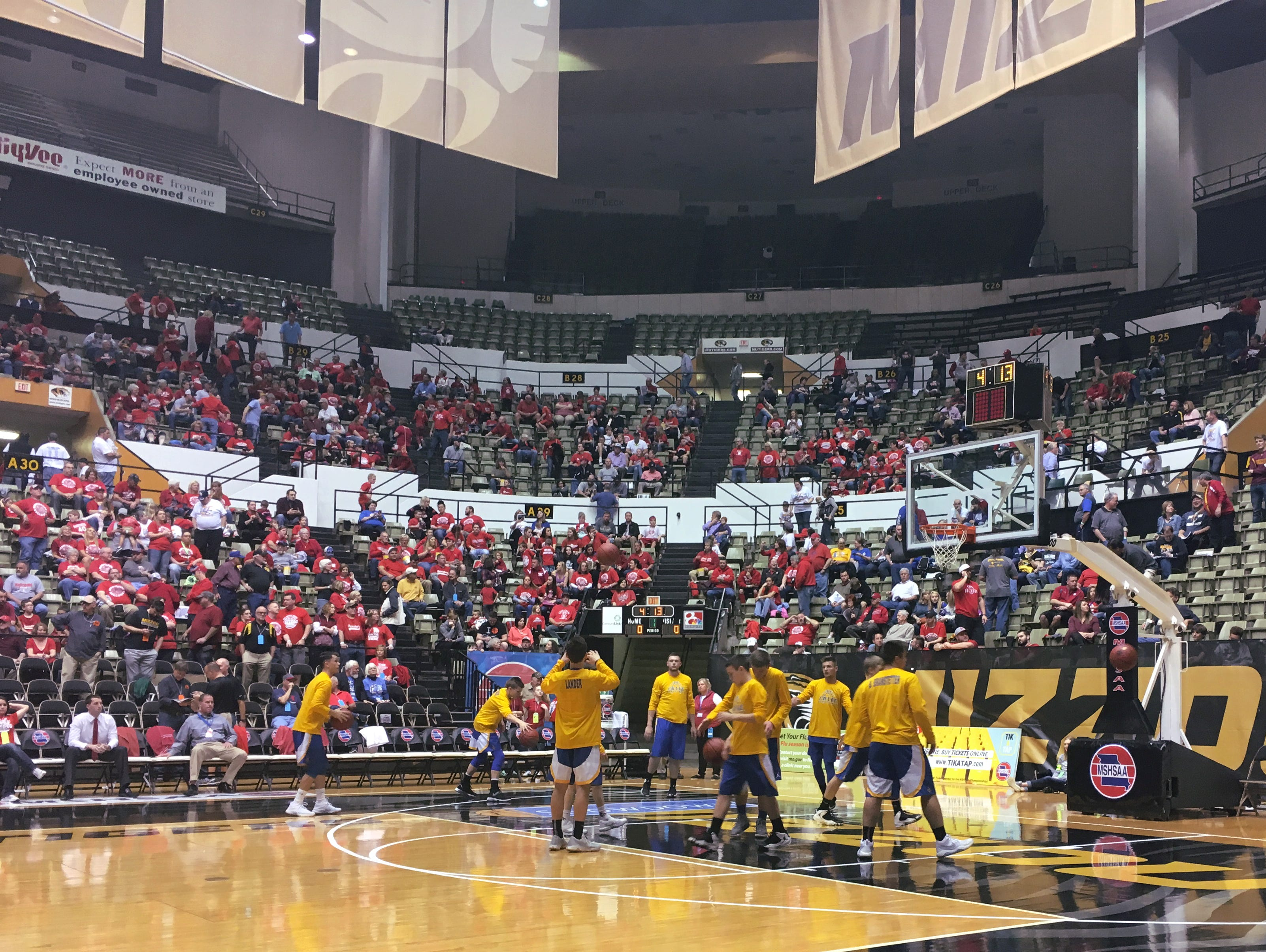 Crane's boys basketball team warms up for a 2017 Class 2 playoff semifinal game against Harrisburg at the Hearnes Center in Columbia.