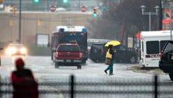 A pedestrian walks through the rain in Montgomery,