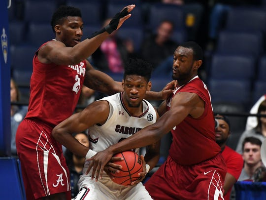 South Carolina Gamecocks forward Chris Silva (30) works against Alabama Crimson Tide forward Braxton Key (25) and forward Jimmie Taylor (10) during the second half of an SEC Conference Tournament game at Bridgestone Arena.