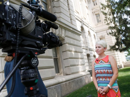 Kirsten Anderson, a former communications director for the Iowa Senate Republican caucus, talks with members of the media Tuesday, July 18, 2017, after Anderson was awarded $2.2 million by a Polk County jury in her sexual harassment case against the state.