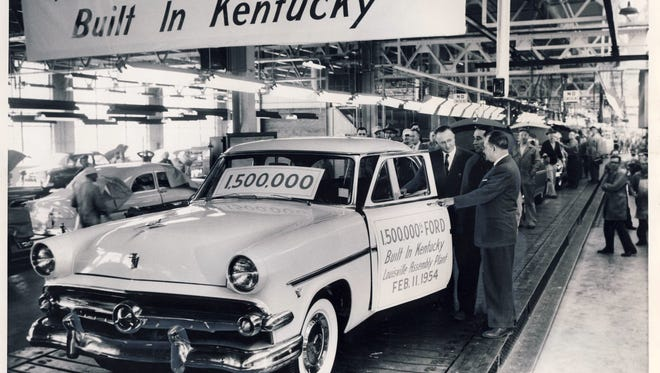The 1.5 millionth Ford vehicle built in Louisville comes off the assembly line in 1954 at the Ford Motor Company plant on Southwestern Parkway.   Witnessing the event are longtime employees Louis F. Millet of Lakeside Drive, middle, and Joseph Crush of Burwell Avenue,  right, in production control.  With them is plant manager Ralph W. Settles.
