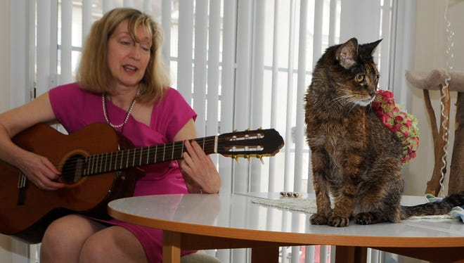 Jennifer Roberts, 61, has changed careers several times, and is now preparing for her next career path.  While at home, she likes to play guitar, sing and is think about working with older folks. She also is involved in animal rescue and has several cats, including Tigger Too.
