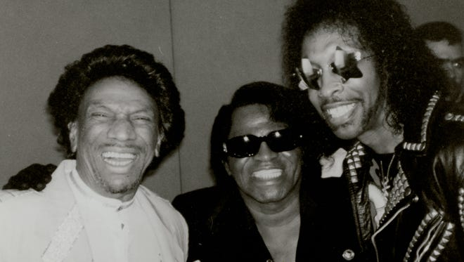 Bootsy Collins (from right) with James Brown and Bobby Byrd in 1996.