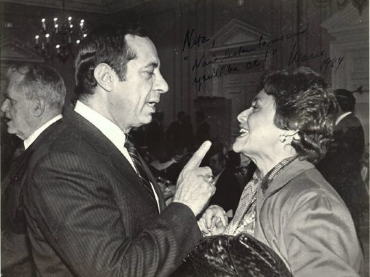 At an event in 1984, then-Gov. Mario Cuomo talks with