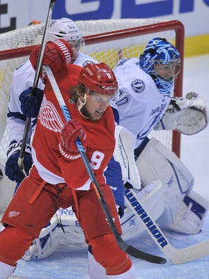 The Red Wings Justin Abdelkader, in his first game since April 4, battles in front of Lightning goalie Ben Bishop on Tuesday.