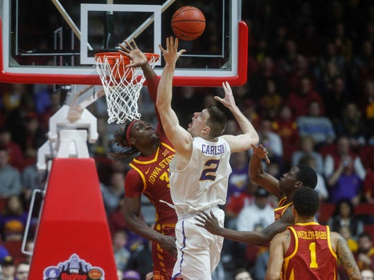 Iowa State sophomore forward Solomon Young, left, blocks the shot of Northern Iowa senior Klint Carlson at Wells Fargo Arena in Des Moines on Saturday, Dec. 16, 2017.