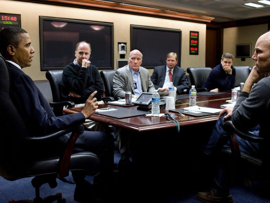 President Barack Obama takes part in a conference call