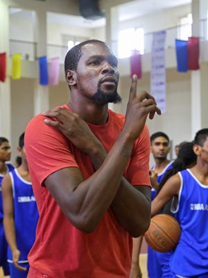 Kevin Durant gestures during his tour of NBA Academy in Greater Noida near New Delhi, India.