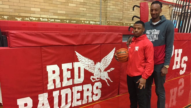 Paulsboro senior Dehron Holloway, left, gets to play for his brother, first-year head coach Daryus Quarles, this season.