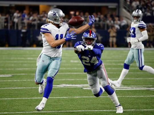 Dallas Cowboys wide receiver Cole Beasley (11) reaches up to catch a pass in front of New York Giants cornerback Eli Apple (24) in the second half of an NFL football game, Sunday, Sept. 10, 2017, in Arlington, Texas. (AP Photo/Michael Ainsworth) ORG XMIT: OTKTG161