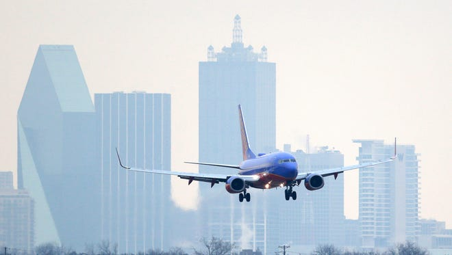 A Southwest Airlines jet lines up for a landing at just before landing at Love Field on Feb. 3, 2014.