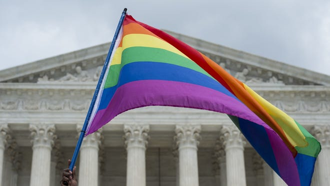 A rainbow flag is flown outside the Supreme Court on June 26, 2015.
