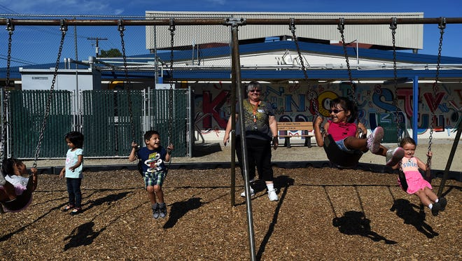 Teacher Lory Rehne watches her pre-kindergarten students play at Booth Elementary School, an older central Reno school.