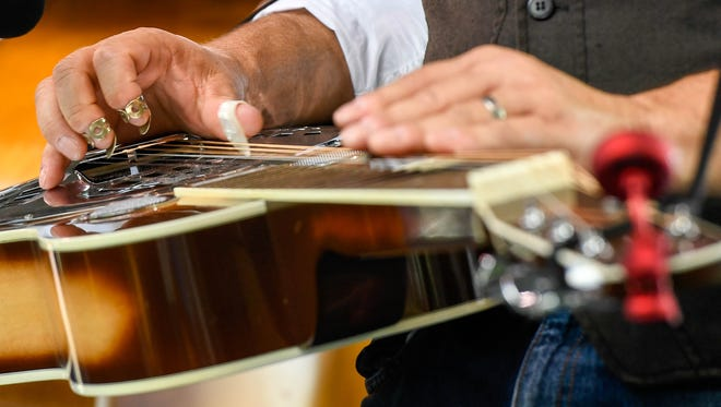 Finger work from Dobro player Chris Joslin as he plays with the Nashville Hayriders at the Bluegrass in the Park Folklife Festival in Henderson's Audubon Mill Park last year.