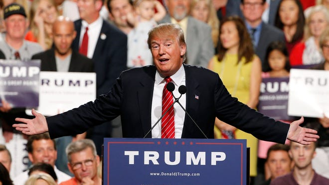 FILE - In this July 11, 2015 file photo, then-Republican presidential candidate Donald Trump speaks before a crowd of 3,500 Saturday, July 11, 2015, in Phoenix. Trump was just a few weeks into his candidacy in 2015 when came to Phoenix for a speech that ended up being a bigger moment in his campaign than most people realized at the time. And now Trump is coming back to Arizona at another crucial moment in his presidency. (AP Photo/Ross D. Franklin) ORG XMIT: LA104