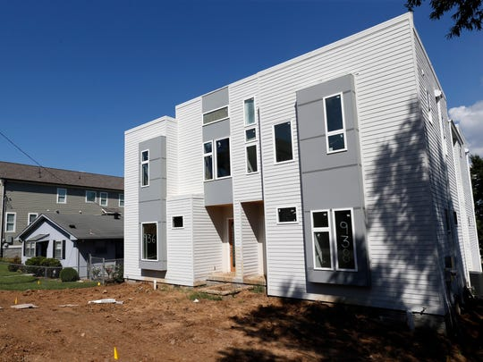 Some homeowners choose to holdout as the neighborhood is redeveloped. Pictured is Southside Place in Nashville.